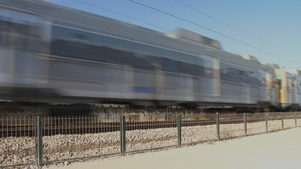 Two commuter train  passing by