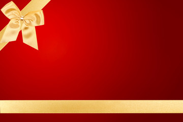Gold Valentine bow on red card