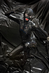 kneeling woman wearing latex clothes