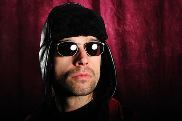 young man with sunglasses and coat cap