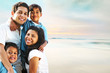 Family Smiling and Embracing Outdoor Beach Portrait