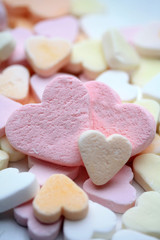 Valentine candy hearts in sweet colors, yes love