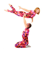 A pair of gymnasts in colorful stage costumes