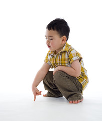 small boy pointing at something