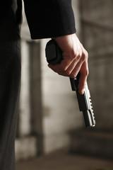 Man holding a .45 caliber gun