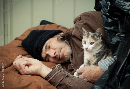Homeless Man and Friendly Stray Kitten