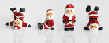 Four funny Santa Clause figurine isolated on white