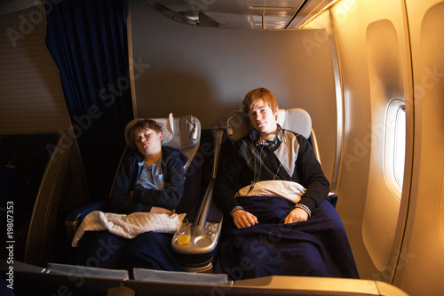 children are relaxing and sleeping in an aircraft