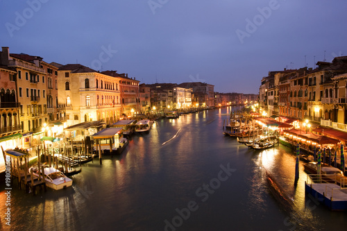 Night life along Venetian Grand Canal by Rialto bridge
