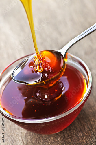Honey dripping onto spoon