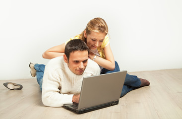 Relaxed couple with laptop computer