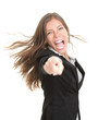 Excited businesswoman pointing