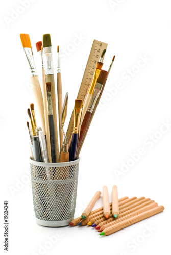 Glass with accessories to drawing and pencils
