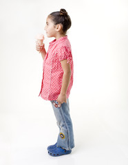 little girl eating ice cream profile