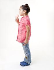 little girl eating ice cream profile