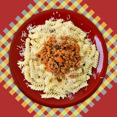 Dish of italian fusilli pasta and bolognese sauce.