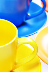 Color cups isolated on white background.