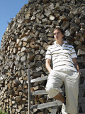 Young Man in Front of Woodpile poster