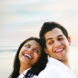 Smiling Faces of Couple In Love Portrait at the Beach