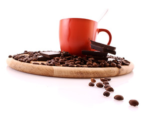 Chocolate, coffee beans and cup with coffee