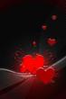 Coeurs rouges et volutes blanches sur fond noir