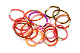 colorful hair elastic bands on white background.. poster