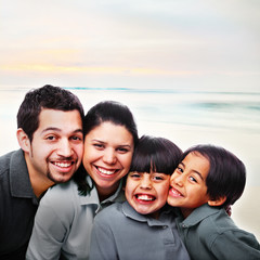 Happy Family Faces Together at the Beach