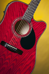 Red Acoustic Guitar on Yellow