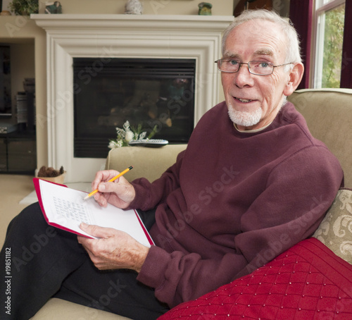 Elderly man relaxing with crossword