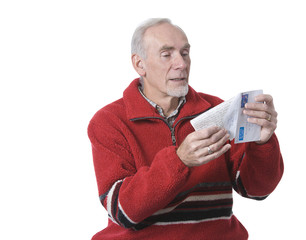Old man opening letter from relative