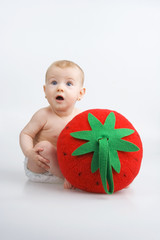 Infant and strawberry.