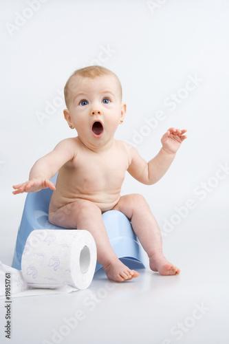 Surprised infant on potty.