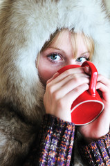 girl with cup of hot  tea