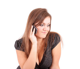 The young woman  speaks on the phone, on a white background, is
