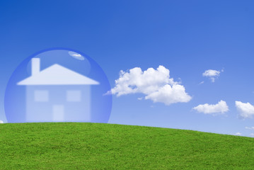House protected by a glass bubble in a green meadow.