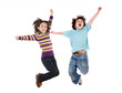 Two happy children jumping at once