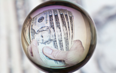 Spherical distortion of man counting 20 dollar bills
