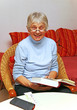 Happy Senior with Book - Seniorin beim Lesen