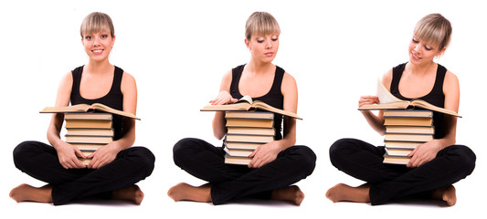Student is sitting with stack of book