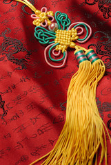 Traditional lucky knot on Jin-Silk background.