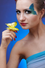 model with butterfly bodyart