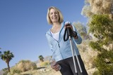 Mature woman holds walking poles