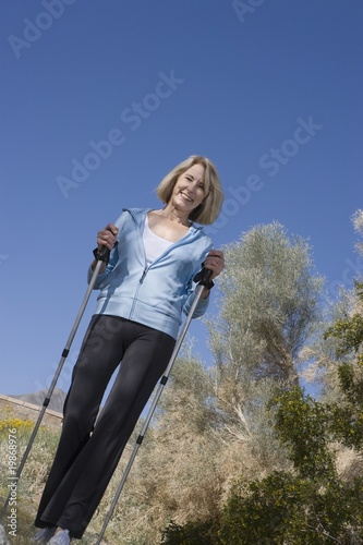 Mature woman with walking poles