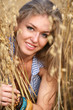 The portrait young woman in the field of wheat.