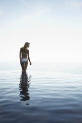 Woman in an infinite pool