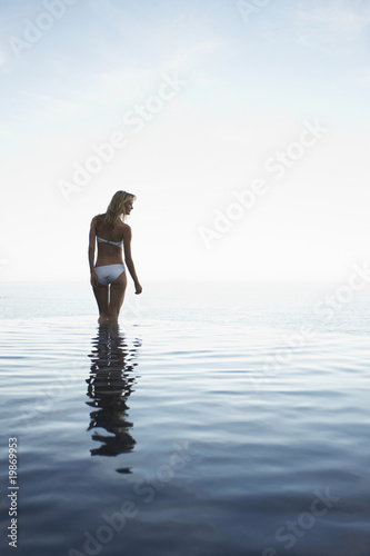 Woman in an infinite pool