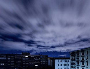 Quickening sky over city buildings