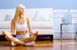 Young Woman Sitting on Wood Floor Meditating