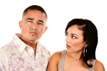 Hispanic wife looks suspiciously at her husband