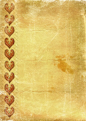 Old yellow paper with hearts